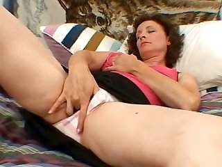 Torrid curly mature lady with big titties is so into petting her messy twat
