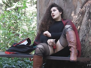 Open-air solo clothed masturbation session with curly haired Lili