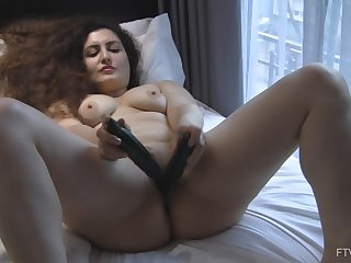 Curvy crude long haired ill-lighted Lili stuffs two dildos in her pussy