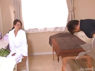Asian MILF oiled with regard to before a kneading and a blowjob