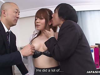 A talented secretary has naughty sex on touching one men in an office